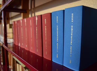 Image of blue and red book spines on a shelf.