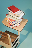 Books stack on a desk (cartoon drawing).